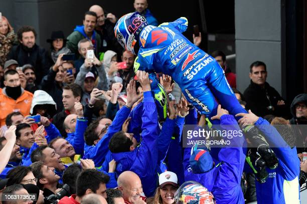 Team SUZUKI ECSTAR's Spanish rider Alex Rins celebrates his second position after the MotoGP race of the Valencia Grand Prix at the Ricardo Tormo...
