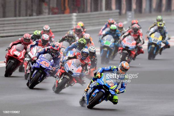 TOPSHOT Team SUZUKI ECSTAR's Spanish rider Alex Rins leads after the start of the MotoGP race of the Valencia Grand Prix at the Ricardo Tormo...
