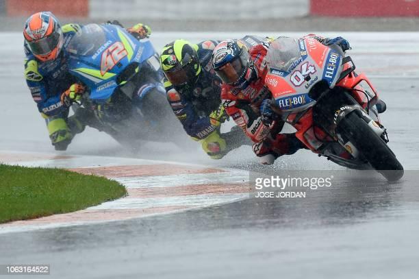TOPSHOT Team SUZUKI ECSTAR's Spanish rider Alex Rins Movistar Yamaha MotoGP's Italian rider Valentino Rossi and Ducati Team's Italian rider Andrea...