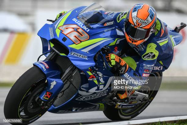 Team Suzuki Ecstar's Spanish rider Alex Rins rides during the second practice session of the Malaysia MotoGP at the Sepang International circuit in...