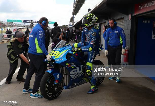 Team Suzuki Italian rider Andrea Iannone prepares to head out on the tracks for the third practice session at Phillip Island on October 27 ahead of...