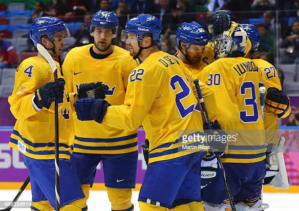 Team Sweden celebrate after defeating Switzerland 10 during the Men's Ice Hockey Preliminary Round Group C game on day seven of the Sochi 2014 Winter...