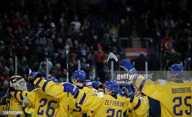 Team Sweden celebrates a win versus Finland at the IIHF World Junior Championships at the SaveonFoods Memorial Centre on December 26 2018 in Victoria...