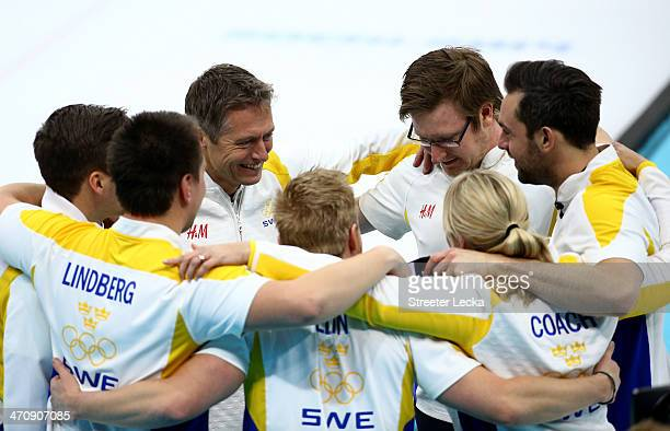 Team Sweden celebrates after defeating China during the Bronze medal game between China and Sweden at the Ice Cube Curling Center on February 21 2014...