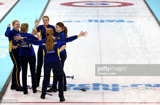 Team Sweden celebrates after defeating Switzerland during the women's curling semifinals at Ice Cube Curling Center on February 19, 2014 in Sochi,...