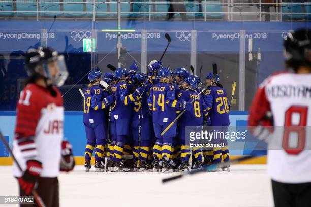 Team Sweden celebrates defeating Team Japan 2-1 in the Women's Ice Hockey Preliminary Round - Group B game on day one of the PyeongChang 2018 Winter...