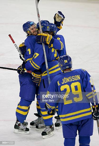 Team Sweden celebrates Niklas Kronwell's second period goal to take a 2-1 lead during the final of the men's ice hockey match between Finland and...