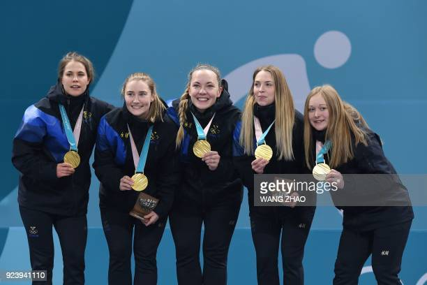 TOPSHOT team Sweden celebrates on the podium during the curling women's medal ceremony at the Pyeongchang 2018 Winter Olympic Games at the Gangneung...