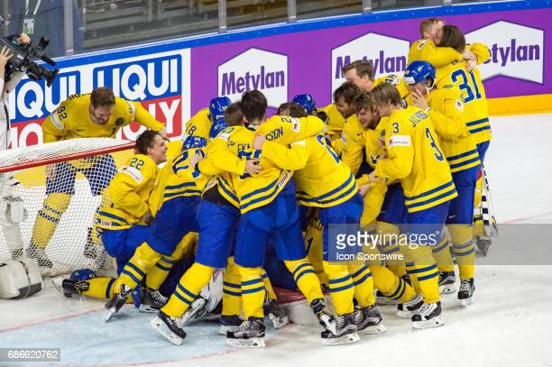 Team Sweden celebrates the win during the Ice Hockey World Championship Gold medal game between Canada and Sweden at Lanxess Arena in Cologne Germany...