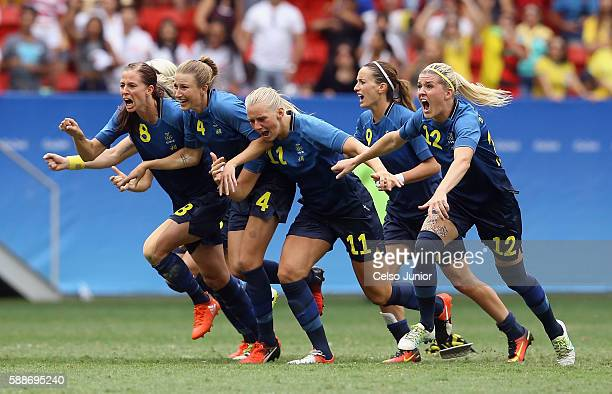 Team Sweden celebrates their 11 win over team United States during the Women's Football Quarterfinal match at Mane Garrincha Stadium on Day 7 of the...