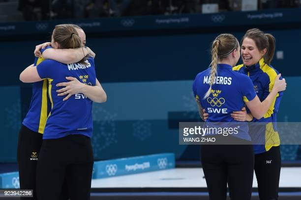 TOPSHOT Team Sweden celebrates winning gold in the curling women's gold medal game between South Korea and Sweden during the Pyeongchang 2018 Winter...