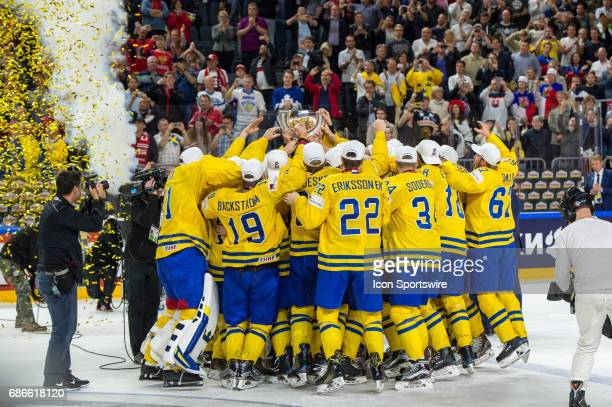 Team Sweden celebrates with the trophy during the Ice Hockey World Championship Gold medal game between Canada and Sweden at Lanxess Arena in Cologne...