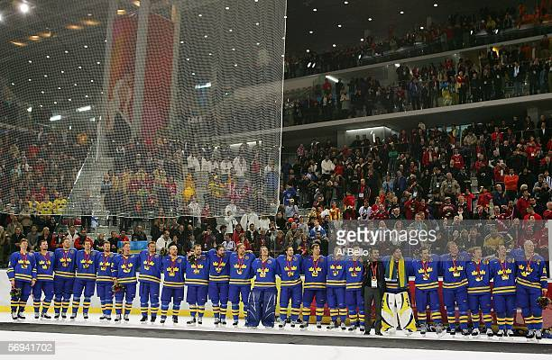 Team Sweden stands with their gold medals after defeating Finland 3-2 in the final of the men's ice hockey match between Finland and Sweden during...