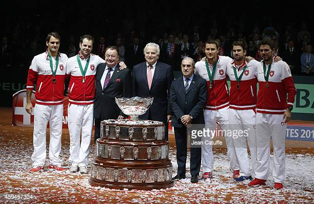 Team Swiss with Roger Federer Stanislas Wawrinka Captain of Switzerland Severin Luthi Marco Chiudinelli and Michael Lammer pose with President of...