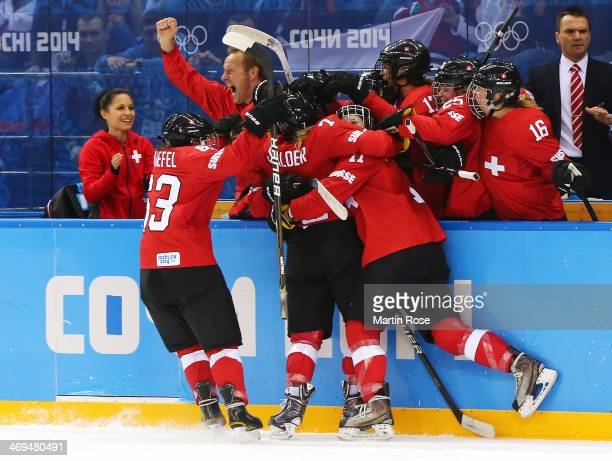 Team Switzerland celebrate the goal by Lara Stadler of Switzerland against Russia during the Women's Ice Hockey Playoffs Quarterfinal game on day...