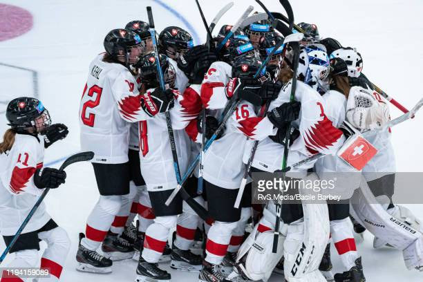 Team Switzerland celebrates the win after Women's 6-Team Tournament Preliminary Round - Group B game between Czech Republic and Switzerland at the...