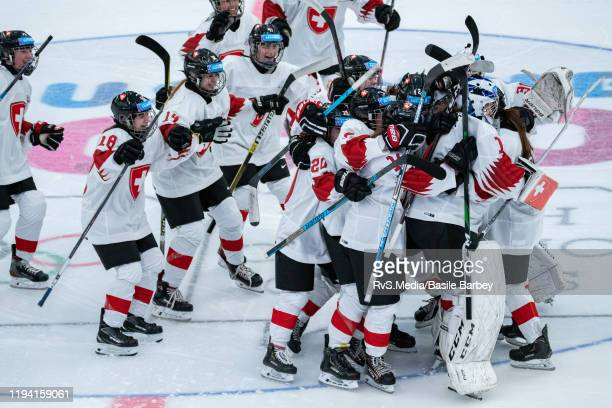 Team Switzerland celebrates the win during Women's 6-Team Tournament Preliminary Round - Group B game between Czech Republic and Switzerland at the...