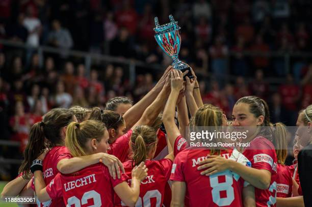 Team Switzerland celebrates with the Silver Medal Trophy after the Gold Medal game of 2019 Women's World Floorball Championships between Sweden and...