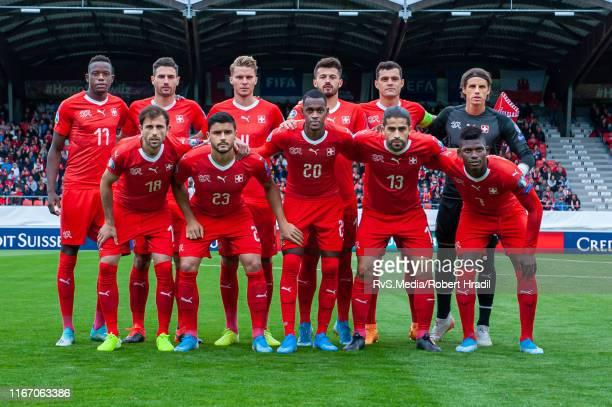 Team Switzerland poses for team photo. From top left: #17 Denis Zakaria, #23 Loris Benito, #11 Renato Steffen, #15 Albian Ajeti, #10 Granit Xhaka and...