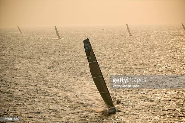 Team Telefonica skippered by Iker Martinez from Spain leads the fleet during the start of Leg 3 of the Volvo Ocean Race 201112 from Abu Dhabi UAE to...