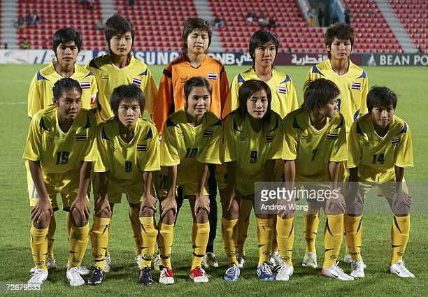 Team Thailand pose for a team photo prior to the 15th Asian Games Doha 2006 Women's Preliminary Round Group A football match between China and...