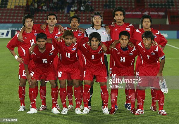 Team Thailand poses for photographers prior to kick off in the Men's Football Round 2 Group C match against Palestinian Territory during the 15th...
