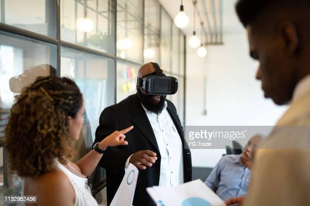 Team thinking about ideas using virtual reality simulator