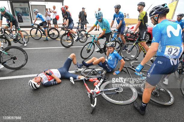 Team Trek rider Denmark's Niklas Eg and Team Movistar rider Spain's Marc Soler lie on the road after falling down during the 1st stage of the 107th...