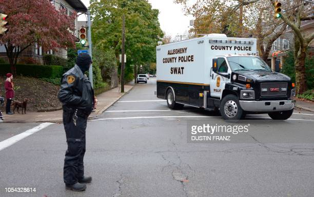 Team truck turns on a street near the Tree of Life Synagogue after a gunman opened fire inside at Squirrel Hill Pennsylvania on October 27 2018 A...
