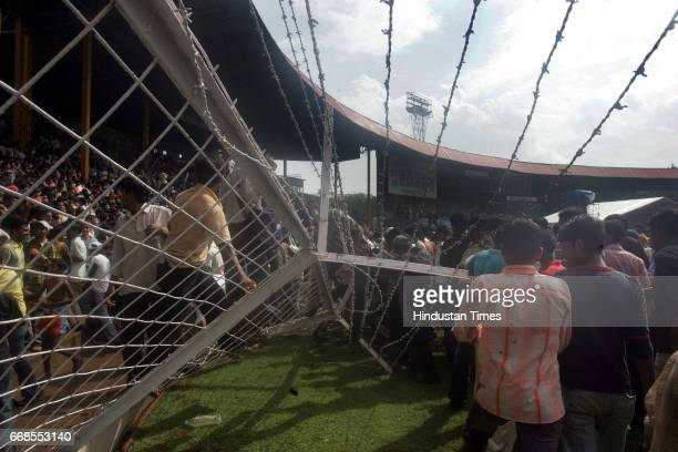 Team Twenty in Mumbai crowd breaks the fence of Wankhede Stadium to get closer look of their cricket stars