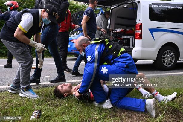 Team UAE Emirates' Marc Hirschi of Switzerland receives medical treatment after a crash during the 1st stage of the 108th edition of the Tour de...