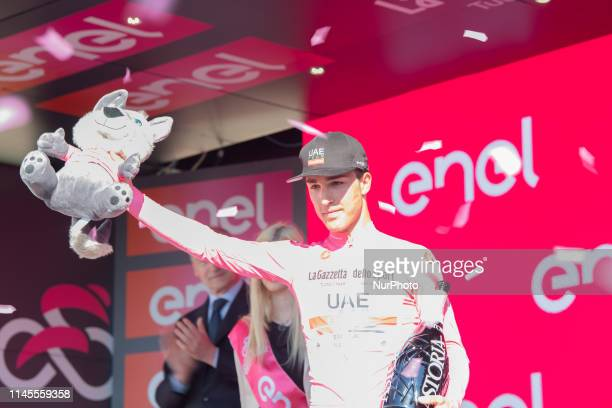 Team UAE Emirates rider Italy's Valerio Conti, overall leader and Pink Jersey holder celebrates on podium in stage 11 of the 102nd Giro d'Italia -...