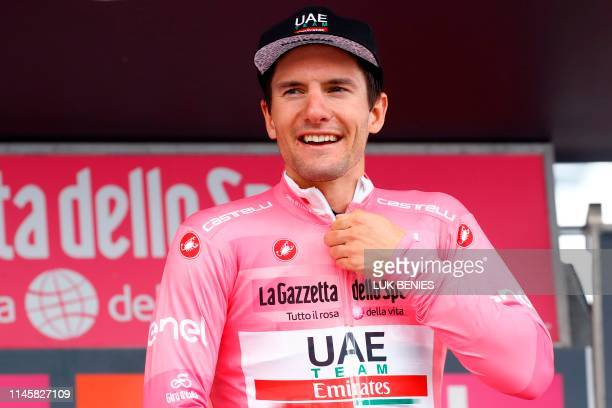 Team UAE Emirates rider Slovenia's Jan Polanc puts on his overall leader's pink jersey on the podium after stage thirteen of the 102nd Giro d'Italia...