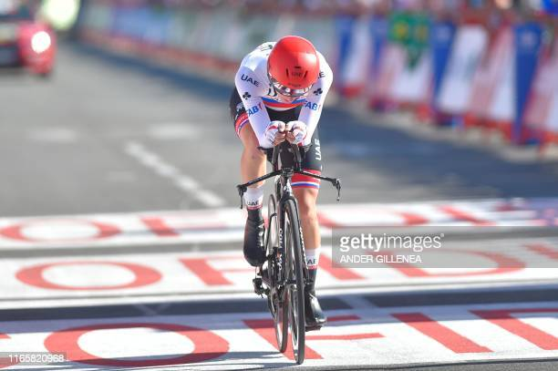 Team UAE Emirates rider Slovenia's Tadej Pogacar crosses the finish line of the tenth stage of the 2019 La Vuelta cycling Tour of Spain, a 36,2 km...