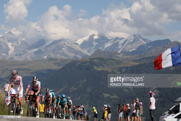 Team UAE Emirates rider Slovenia's Tadej Pogacar wearing the best climber's polka dot jersey rides during the 18th stage of the 107th edition of the...