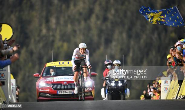 Team UAE Emirates rider Slovenia's Tadej Pogacar wearing the best young's white jersey crosses the finish line at the end of the 20th stage of the...