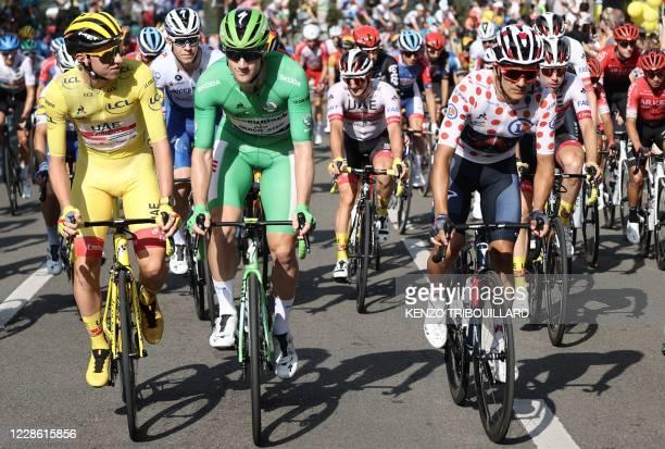 Team UAE Emirates rider Slovenia's Tadej Pogacar wearing the overall leader's yellow jersey, Team Deceuninck rider Ireland's Sam Bennett wearing the...
