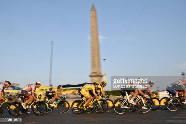 Team UAE Emirates rider Slovenia's Tadej Pogacar wearing the overall leader's yellow jersey rides in the pack around the Obelisk of Luxor on the...