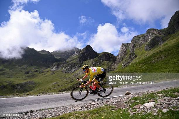 Team UAE Emirates' Tadej Pogacar of Slovenia wearing the overall leader's yellow jersey descends the Tourmalet pass during the 18th stage of the...