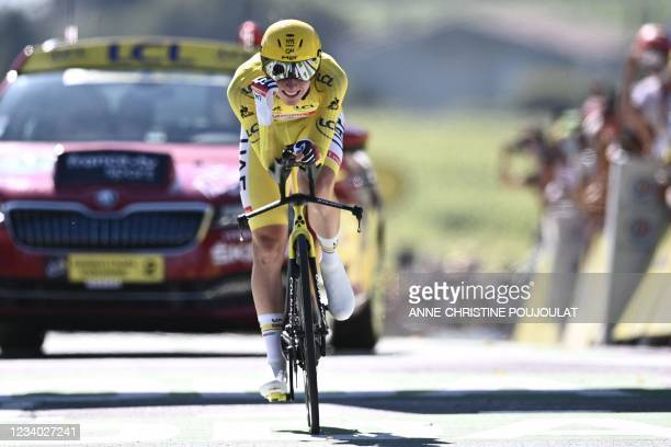 Team UAE Emirates' Tadej Pogacar of Slovenia wearing the overall leader's yellow jersey crosses the finish line during the 20th stage of the 108th...