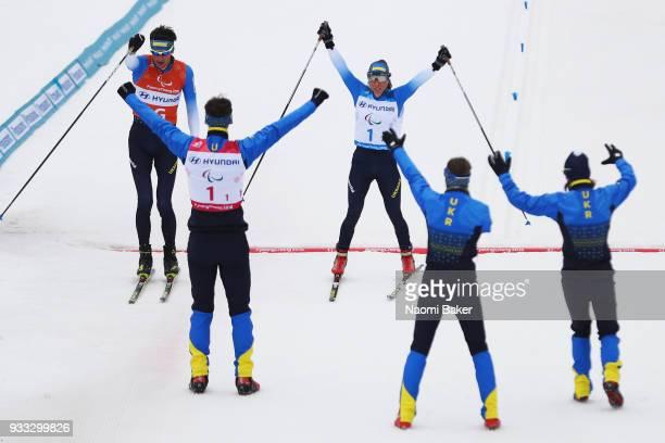 Team Ukraine celebrate as Oksana Shyshkova and her guide Vitaliy Kazakov cross the finish line to win the Gold medal for the 4x25km mixed relay...