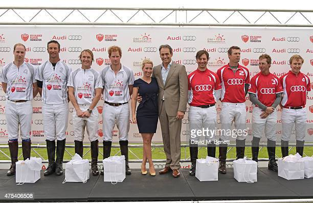 Team Ultra players Prince William Duke of Cambridge John Paul Clarkin Mark Tomlinson and Prince Harry Christine Sieg Andre Konsbruck Director of Audi...