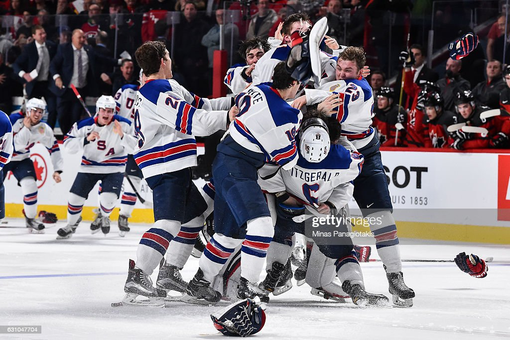 Team United States celebrate as they win gold during the 2017 IIHF World Junior Championship gold medal game against Team Canada at the Bell Centre on January 5, 2017 in Montreal, Quebec, Canada.