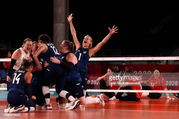 Team United States celebrate victory after winning the Women's Sitting Volleyball gold match between China and The United States of America on day 12...