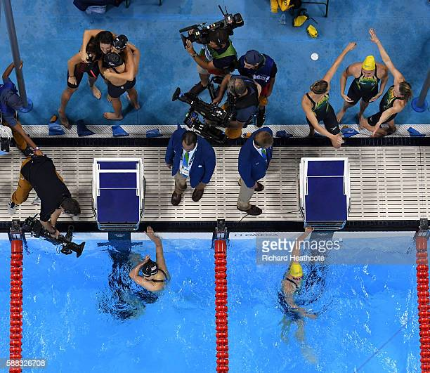 Team United States celebrate winning gold as Team Australia celebrate silver in the Women's 4 x 200m Freestyle Relay Final on Day 5 of the Rio 2016...