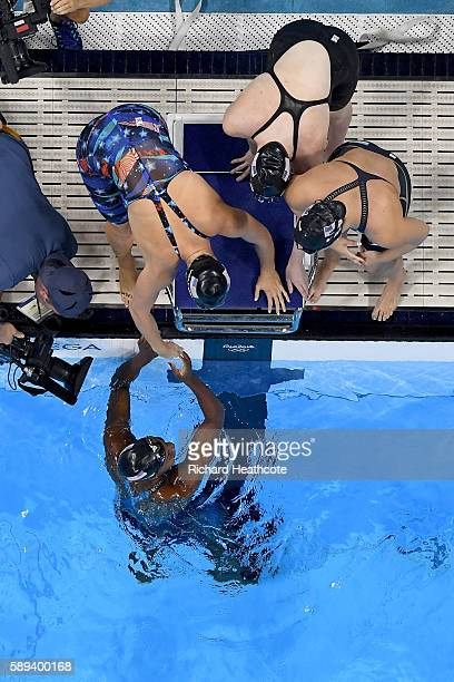 Team United States celebrate winning gold in the Women's 4 x 100m Medley Relay Final on Day 8 of the Rio 2016 Olympic Games at the Olympic Aquatics...