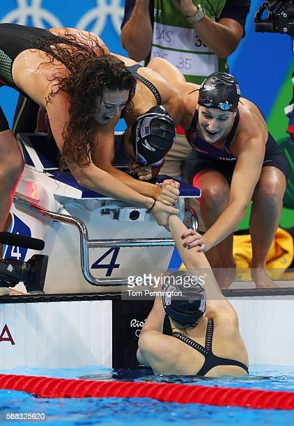 Team United States celebrate winning the Women's 4 x 200m Freestyle Relay Final on Day 5 of the Rio 2016 Olympic Games at the Olympic Aquatics...