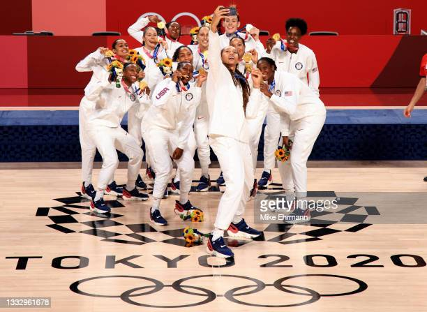 Team United States celebrate with their gold medals during the Women's Basketball medal ceremony on day sixteen of the 2020 Tokyo Olympic games at...