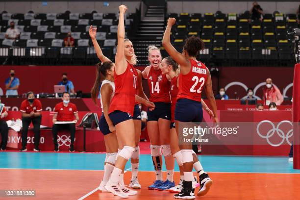 Team United States celebrates after defeating Team Italy during the Women's Preliminary - Pool B volleyball on day ten of the Tokyo 2020 Olympic...
