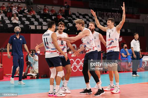 Team United States celebrates against Team ROC during the Men's Preliminary Round - Pool B volleyball on day three of the Tokyo 2020 Olympic Games at...